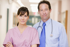 Doctor And Nurse Standing In A Hospital Corridor Royalty Free Stock Photography