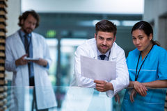 Doctor and nurse standing in hospital Stock Image