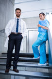 Doctor and nurse standing on staircase Stock Image