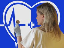 Doctor or nurse with stethoscope in hand. Image of heart, medical cross and electrocardiogram on background. Concept of medical stock photography