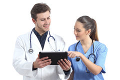 Doctor and nurse student working with a tablet. Isolated on a white background Stock Photography
