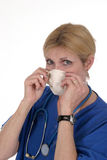 Doctor or Nurse with Surgical Mask 3. Photo of nurse or doctor with stethoscope putting on a surgical mask stock image