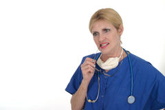 Doctor or Nurse Thinking 9. Photo of nurse or doctor with stethoscope and glasses in mouth thinking, in thought Royalty Free Stock Images