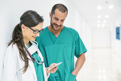 Doctor and nurse using mobile. royalty free stock photography