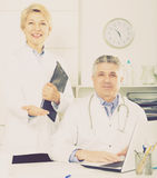 Doctor and nurse waiting for patients Stock Photo