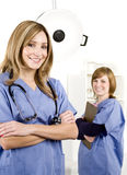 Doctor and nurse in white hospital Stock Images