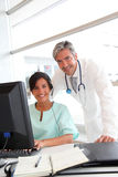 Doctor and nurse working in office Royalty Free Stock Images