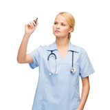 Doctor or nurse working with something imaginary Royalty Free Stock Photography
