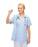 Doctor or nurse working with something imaginary Stock Images