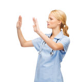 Doctor or nurse working with virtual screen Stock Image