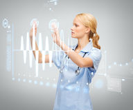Doctor or nurse working with virtual screen Royalty Free Stock Photography