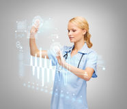 Doctor or nurse working with virtual screen Stock Photography