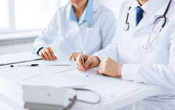 Doctor and nurse writing prescription paper. Picture of doctor and nurse writing prescription paper Royalty Free Stock Images