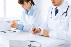 Doctor and nurse writing prescription paper. Picture of doctor and nurse writing prescription paper Stock Images