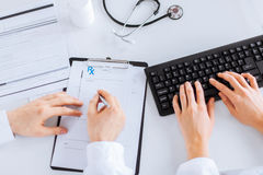 Doctor and nurse writing prescription paper. Picture of doctor and nurse writing prescription paper Royalty Free Stock Photo