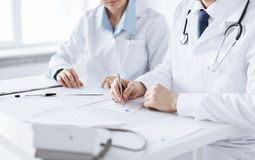 Doctor and nurse writing prescription paper Royalty Free Stock Image