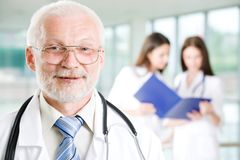 Doctor with  nurses Stock Photography