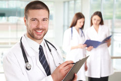 Doctor with nurses stock photo