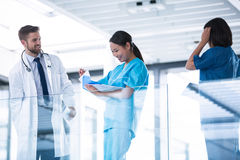 Doctor and nurses having a conversation Royalty Free Stock Images
