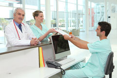 Doctor and nurses in hospital. Smiling doctor and nurses in hospital Royalty Free Stock Photo