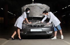 The doctor and nurses repair the car Stock Photos