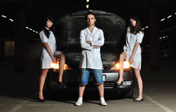 Three doctors in front of car Royalty Free Stock Photo