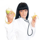 Doctor Nutritionist with Fruit Stock Images