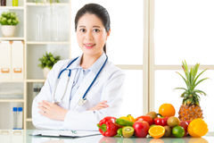 Doctor nutritionist with fruits and vegetable. Health eating Royalty Free Stock Image