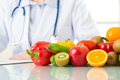 Doctor nutritionist with fruits and vegetable. Health eating Royalty Free Stock Photo