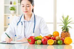 Doctor nutritionist with fruits and vegetable. Health eating Royalty Free Stock Photography