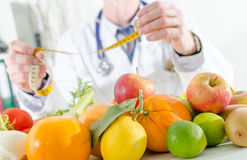 Doctor nutritionist with healthy fruits Stock Photo