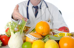 Doctor nutritionist showing healthy fruits and vegetables Royalty Free Stock Photo