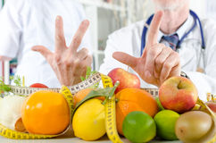 Doctor nutritionist showing a prescription Stock Image