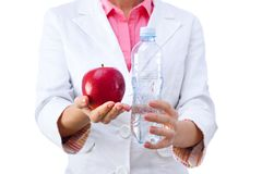 Doctor Nutritionist Woman holding health food and Stock Photography