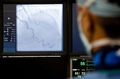 Doctor observing angiography machine Royalty Free Stock Images