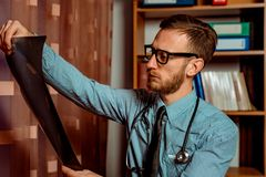 Doctor Observing X-Ray stock image