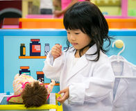 Doctor occupation role playing girl Royalty Free Stock Photography