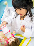 Doctor occupation role playing girl Stock Photography