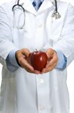 Doctor offering apple Royalty Free Stock Photo