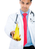 Doctor offering bananas Royalty Free Stock Photography