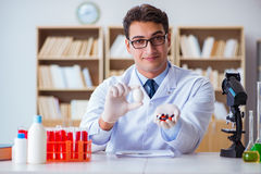 The doctor offering the choice between healthy and vitamins Stock Photo