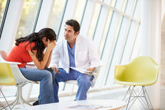 Doctor Offering Counselling To Depressed Woman. In Hospital Royalty Free Stock Photos