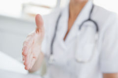 Doctor offering a hand to shake Stock Photos