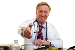 Doctor offering a handshake Royalty Free Stock Photos
