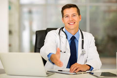 Doctor offering handshake Royalty Free Stock Photos
