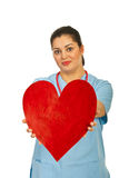 Doctor offering heart shape Stock Photography