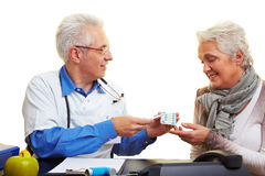 Doctor offering medication Royalty Free Stock Photography