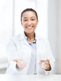 Doctor with offering pills Stock Photos