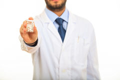 Doctor offering pills on white background Stock Image