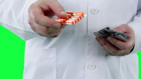 Doctor offers to take the pill closeup. Chroma key background stock video footage
